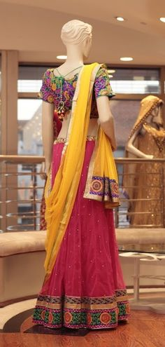 Embroidery: Thread Work.  Fabric: Net skirt, Net Dupatta, and Raw Silk Blouse.  For more information please contact sales@sahil.com