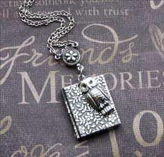 Hey, I found this really awesome Etsy listing at http://www.etsy.com/listing/62949608/silver-book-locket-necklace-enchanted