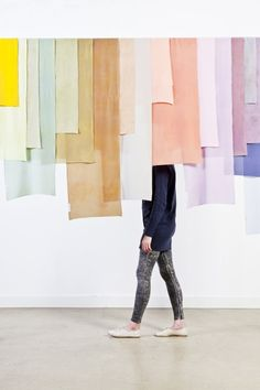 Hanging large strips of fabric.