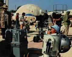 The guy who played R2 D2 (Kenny Baker) chows down on a sandwich while on the set of Star Wars