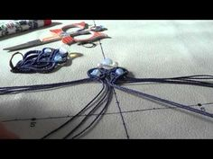 This is how I made this macrame earring. You can watch knotting half hitches, double half hitches, adding beads, decreasing number of cords without cut and b...