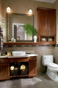 Waypoint bathroom cabinetry with over-the-toilet storage in style 630F in Cherry Chocolate