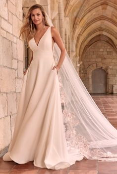 Time to end the notion that simple gowns are doomed to disappoint. This minimalist crepe A-line wedding dress is meant to be admired from every angle. Crepe Wedding Dress, Maggie Sottero Wedding Dresses, Classic Wedding Dress, Black Wedding Dresses, Perfect Wedding Dress, Designer Wedding Dresses, Wedding Gowns, Wedding Veil, Bridal Dresses
