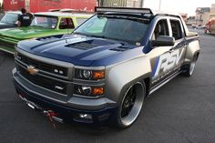 Roadster shop chevy truck widebody kit brushed wheels grey blue