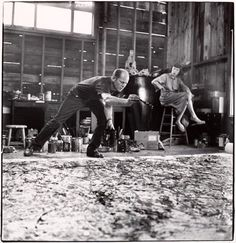 "Lee Krasner watching her husband Jackson Pollock work on one of his ""action paintings""….at their studio / house in New York….:"