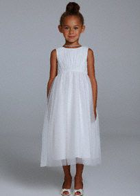 Your flower girl will light up the room in this sparkling sensation! This tank tulle ball gown features eye-catching all over sparkling detail. Tulle floor length skirt adds dimension and gives this dress a princess feel. Fully lined. Back zip. Imported polyester. Dry clean only.The ball gown is a classic shape with a fitted bodice and very full skirt that brushes the floor. The pick-up skirt is a modern interpretation of this silhouette.A sheer to semi-sheer net fabric often used for…