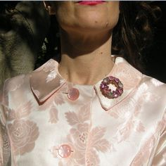 Pink satin empire waist jacket shines with a rhinestone brooch. So 60s!