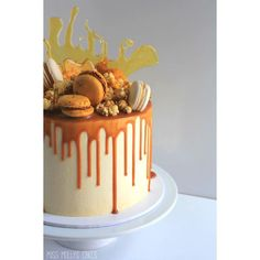 """Chocolate Salted Caramel Cake w caramel ganache drip, caramel popcorn, macaroons and toffee #missmollyscakes #melbournecakes"""
