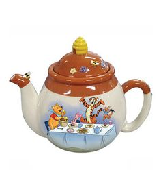 Serve guests with an extra ounce of charm using this Pooh-themed teapot. Adorably adorned with flowers and bees on the lid and featuring a bright image of a Hundred Acre Wood party, it's sure to add joy to any gathering.