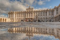Royal Palace in Madrid by Wojciech Toman. With 20 square km of tapestry and the largest candelabra in Europe, the impossibly luxurious Royal Palace lounges at the west tip of central Madrid.Designed after Bernini's rejected designs for the Louvre it was built for the first Bourbon King Felipe V. Beautiful gardens and parks swathe the Royal. In the front lies  Plaza de Oriente, a semicircle lined with statues of monarchs.