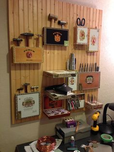 My crafty tool rack for the new studio. Repurposed cigar boxes.