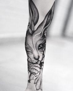 freehand blackwork bunny tattoo by @wpkorvis