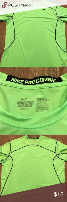 Nike pro fit combat workout shirt neon green! Fitted, so it will be a little snug. But this thing is ready for the gym, and they'll see ya comin in this neon! Great condition and comes from a smoke free and pet free home Nike Shirts Tees - Short Sleeve
