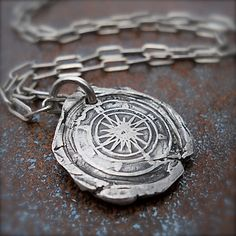 Silver Compass Wax Seal Jewelry Pendant.  Mens Jewelry that is Unique and spectacular. A personal talisman for the man (or woman!) who loves travel, adventure, or the sea.  FOR CENTURIES, the symbolic image of a compass has been used for navigation and often given to sailors for luck in finding their way home. It also embodies the idea of staying focused and moving in the right direction, making this a perfect talisman for someone starting out on a new journey in life.  This listing is for…