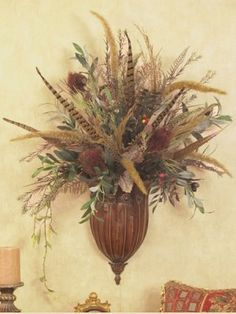 World Market inspired aurora brown wall sconce with an assortment of wildflowers in natural tones, accented with foxtail and pheasant feathers blends with almost any decor.