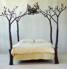 a bed with metal tree posts