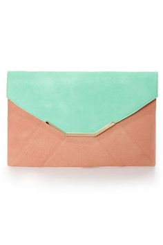 Check it out from Lulus.com! And the award for adorableness goes to... The Envelope, Please Mint and Peach Clutch! Oversized envelope stylings look extra chic in a combo of burnished mint green and dusty peach, with a paneled front construction, and a squared-off top flap that's trimmed with a cool golden tip. Pop open magnetic button closure to reveal a slender interior with satin lining and a secure zippered pocket. 46