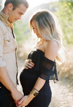 Love how he is looking at her and she's looking down at her stomach...beautiful