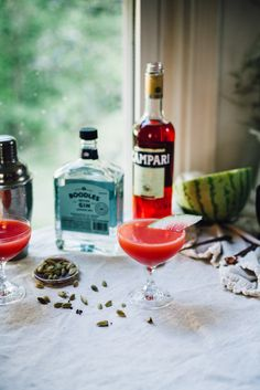 the sugar hollow | Watermelon Juice      1 cup roughly chopped seedless watermelon, rind removed  Cocktail      1 inch lime peel     1.5 ounces gin     1 teaspoon campari     .5 ounces lime juice     1 teaspoon maple syrup (or simple syrup)     4 ounces watermelon juice     ⅛ teaspoon black cardamom, ground     2 ice cubes     Optional: thin slice of watermelon rind, to garnish