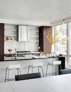 Love the hints of yellow in the clean open space.  TheDesignerPad - The Designer Pad - SUNNY INMANHATTAN