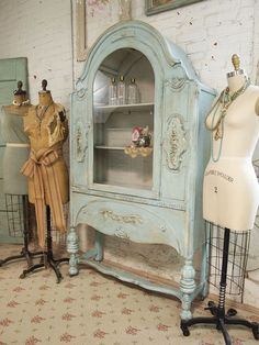 Vintage painted china cabinet in aqua.