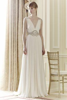"""Brides.com: Jenny Packham - Spring 2014. """"Daphne"""" a-line wedding dress with plunging v-neckline and embellished waist and straps, Jenny Packham."""