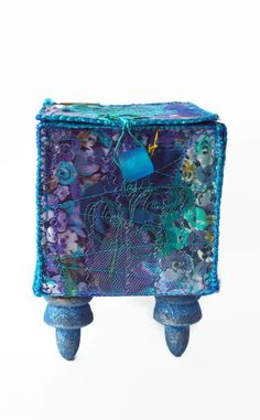Purple Blue Garden - unique fiber art box I love the colours in this box. Its a riot of colour, like a summer garden. It could be used for lightweight jewellery or keepsakes, or just as a decorative item for the home. I have used a variety of fabrics layered with organzas, lace and netting, melded together with machine embroidery, and created a truely unique piece of fiber art. The lid is weighted with a frosted blue glass bead and I made hinges at the back for easier opening. The box…