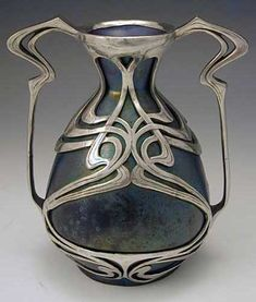 Zsolnay art nouveau vase, 1900.  Ceramic with polished pewter overlay.... luv this!