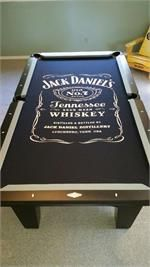 Jack Daniels pool table room themed using a Brunswick Bayfield, gray rail cloth and a Jack Daniels pool cloth