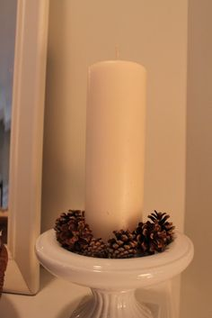 Winter Decor: candles and pinecones