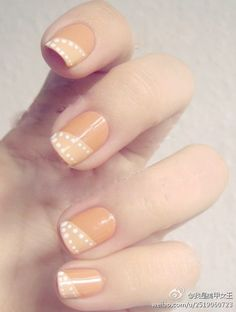 Dotted diagonal French manicure. Done best with a pastel gradient in the colors used.