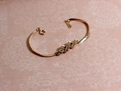 Avon Gold Tone Swirl Bracelet with rhinestones by FrogTears on Etsy