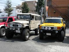 FJ45 troopy and fj cruiser. nice to see them side by side. Love FJ45.