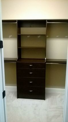 New closets in lutz fl. This is a repeat customer from 5 years ago. Dark Brown Walk In Closet. #customclosets