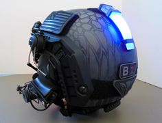 My Gunfighter ballistic helmet with NVG mount and IPSC noise cancelling Comtac II rail mounted headset with NE red/IR LED.