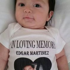 This adorable little man is wearing a very special onesie made in tribute to his uncle.