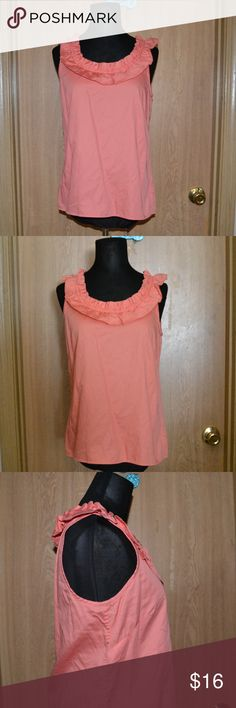 J.crew coral ruffled  blouse Smoke free home. BUY 3 GET ONE FREE!! I ship monday -friday! NO HOLDS OR TRADES. A gorgeous coral sleeveless blouse size 4 by the brand J.Crew. In very good condition. 100% cotton J. Crew Tops Blouses