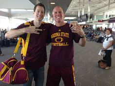 DJ's father Darryll and an unnamed ASU fan heading to Colorado for September 2014 matchup against the Buffalos.