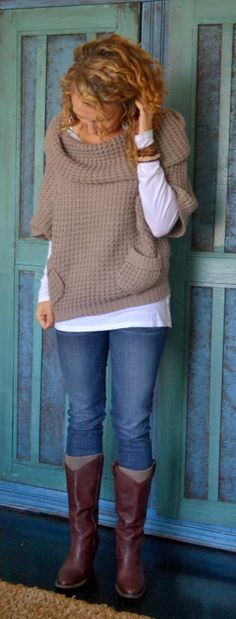 Very cool outfit...  love the slouchy knitted pocket sweater over the white long-sleeved tee.