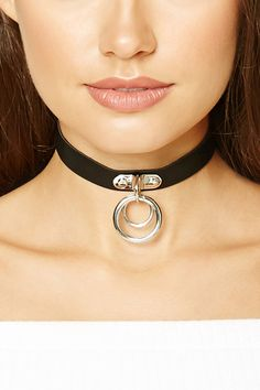 A faux leather choker featuring two high-polish ring charms and lobster clasp closure.