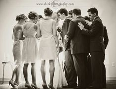 couples praying together | Wedding party praying over couple this is a awesome idea to have the parents and the bridesmaid and grooms men pray over us!
