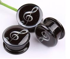 Treble Clef Ear Plug Expander Tunnel  This funky treble clef Screw-fit, Ear Stretcher Flesh Plug Tunnel Expander in Acrylic will add a great new look to your piercings.  Add a funky look to your unique style with ear stretchers. They make it easy to stretch your ear as much as you want with different sizes,  from 4 mm to 16mm.  Ear stretchers get you that tough punk look and show your individuality!  Great for Musicians or anybody who loves their music!  Please note this listing is for one…