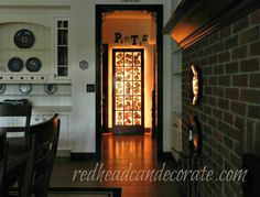 Illuminate your dark hall w/ a french door loaded with photos & light it up with rope lights in the back.  ~redheadcandecorate.com
