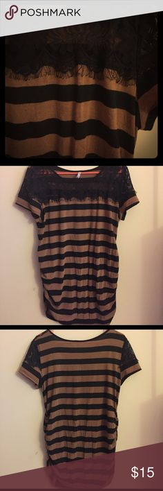 striped blouse with black lace maternity This blouse has rushing on the side and beautiful black lace at the too. I wore it a few times and there is some pilling. It's in great condition! Planet Motherhood Tops Blouses