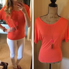 """""""Orange You Glad I'm Selling This"""" T-shirt NWT  You will get noticed in this color there's no doubt about it whether you are going casual or out in the night  Wear alone or over a long tank add a great necklace and you are ready to go Tops Tees - Short Sleeve"""