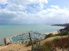 Il porto, il mare, l'orizzonte d'Africa