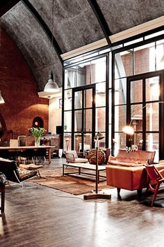 Reclaimed materials,warehouse lighting and urban loft furniture can give your home character, patina and simple style! My son lives in an industrial style loft in the former Chown Pella Window Factory.