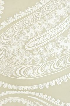 Rajapur Paisley Wallpaper A large contemporary paisley design in white on a very light khaki green background.