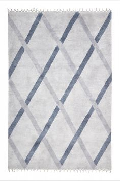 with a design geometrical pattern in neutral colors like grey, blue, navy, also on requirement dimension and color like Rugs for different area like living room, bedroom or even good for dining table. hand made with a beautiful and bright texture.