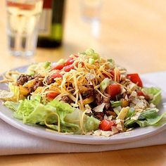 INGREDIENTS: 12 ounces ground round 2 cups chopped yellow, red, or green bell pepper 2 cups bottled salsa 1/4 cup chopped fresh cilantro 4 cups coarsely chopped romaine lettuce 2 cups chopped plum tomato 1 cup (4 ounces) shredded reduced-fat sharp cheddar cheese 1 cup crumbled baked tortilla chips (…